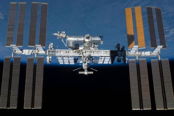 THE INTERNATIONAL SPACE STATION HAS MADE ITS 100,000TH ORBIT OF EARTH, A DISTANCE EQUIVALENT TO 10 R