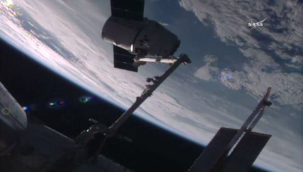 GOT IT! ASTRONAUTS CAPTURE SPACEX DRAGON SUPPLY SHIP AT SPACE STATION