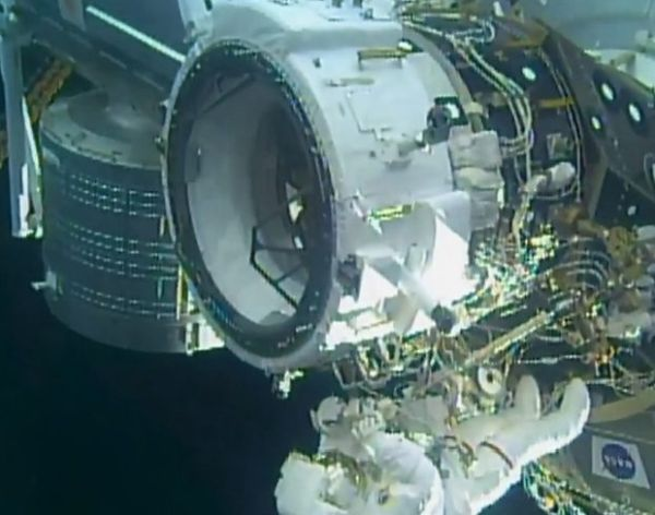 SPACE STATION CREW INSTALLS A NEW FRONT DOOR FOR SPACEX AND BOEING SPACESHIPS