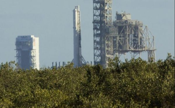 FIRST SPACEX FALCON 9 ERECTED AT HISTORIC LAUNCH PAD 39A FOR FEB. 18 BLASTOFF
