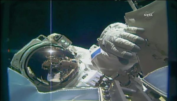 SPACEWALKING ASTRONAUTS PREP SPACE STATION TO DOCK WITH COMMERCIAL SPACESHIPS
