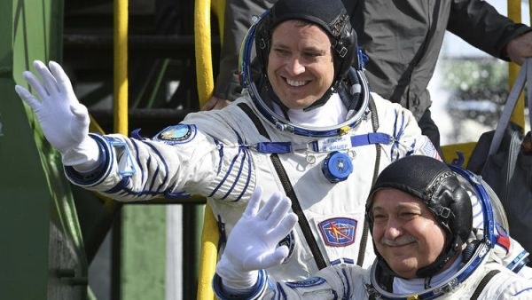 SOYUZ SPACE CAPSULE WITH AMERICAN, RUSSIAN ONBOARD ARRIVES AT INTERNATIONAL SPACE STATION