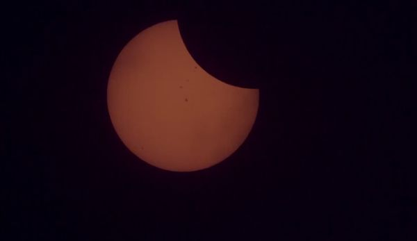 WATCH THE INTERNATIONAL SPACE STATION TRAVEL ACROSS THE SOLAR ECLIPSE