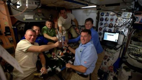 ASTRONAUTS CELEBRATE THANKSGIVING ABOARD INTERNATIONAL SPACE STATION