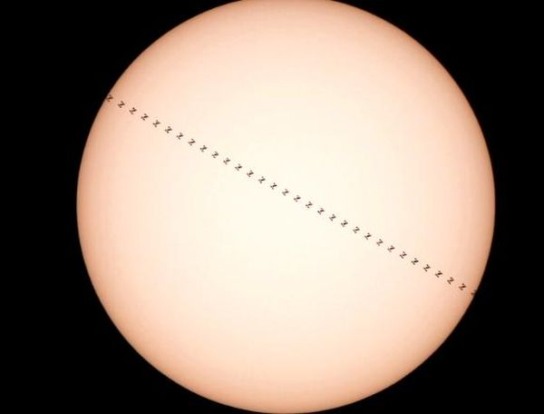 CHECK OUT THIS PHOTO OF THE SPACE STATION PASSING BETWEEN THE EARTH AND THE SUN