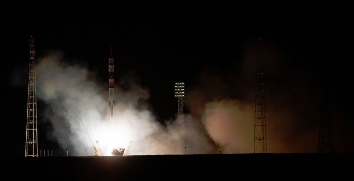 SOYUZ TAKES OFF WITH THREE BOUND FOR SPACE STATION