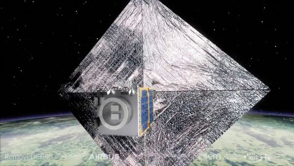 1ST SATELLITE BUILT TO HARPOON SPACE JUNK FOR DISPOSAL BEGINS TEST FLIGHT