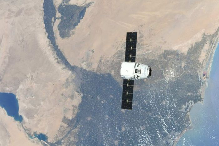 Dragon capsule reaches space station with three tons of cargo
