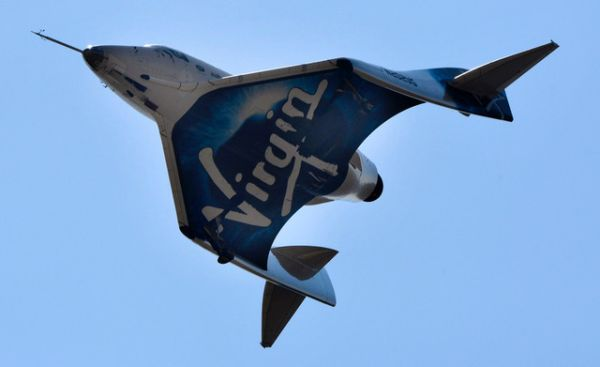 Virgin Galactic's rocket plane climbs closer to space