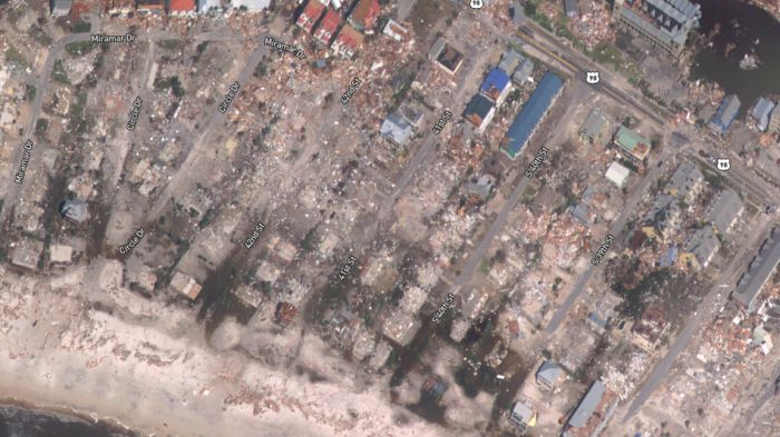 SATELLITE PHOTOS SHOW HOMES, FORESTS, AND A MILITARY BASE DESTROYED BY HURRICANE MICHAEL