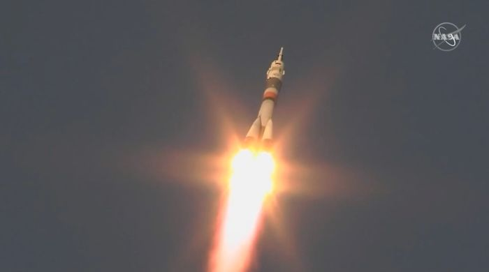 Soyuz crew enjoys problem-free launch, heads for space station