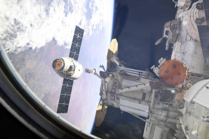 DRAGON CARGO CRAFT RETURNS TO EARTH