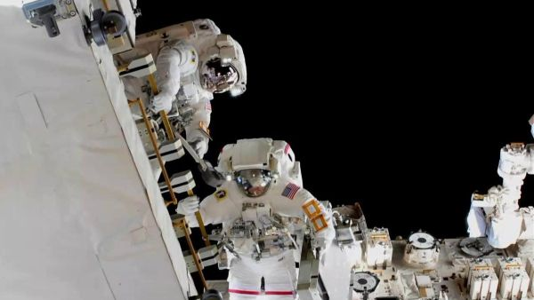 ASTRONAUTS INSTALL NEW BATTERIES OUTSIDE THE INTERNATIONAL SPACE STATION
