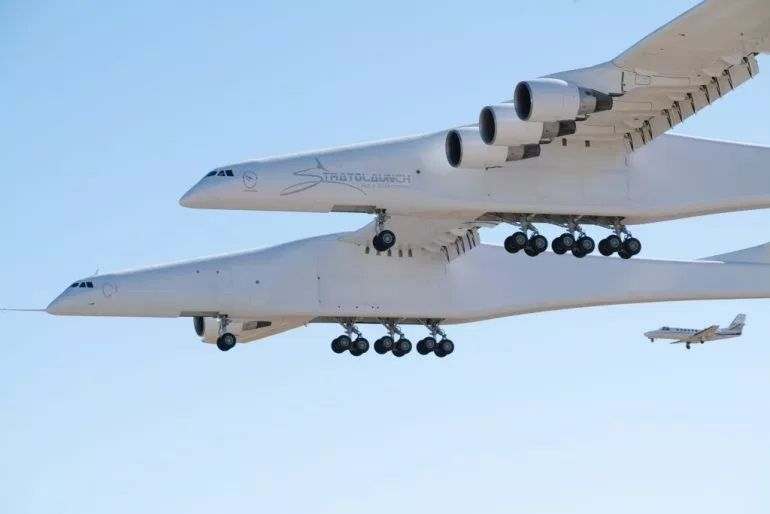 WORLD'S LARGEST PLANE, DESIGNED TO CARRY SATELLITE-LOADED ROCKETS, TAKES OFF FOR 1ST TEST FLIGHT