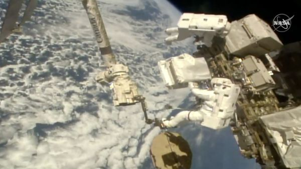 ASTRONAUTS REPAIR COSMIC RAY DETECTOR OUTSIDE INTERNATIONAL SPACE STATION