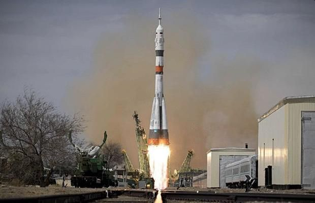 UPGRADED SOYUZ ROCKET WITH CREW OF THREE LAUNCHED TO SPACE STATION