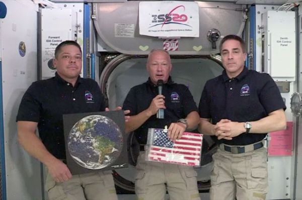ASTRONAUTS 'CAPTURE THE FLAG' FOR SPACEX IN RACE TO REACH SPACE STATION