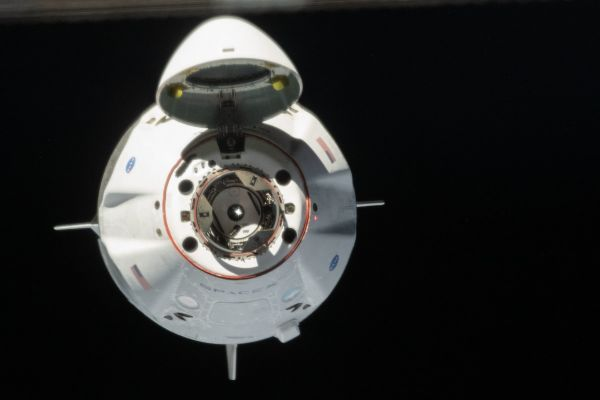 NASA AGREES TO FLY ASTRONAUTS ON REUSED CREW DRAGON SPACECRAFT
