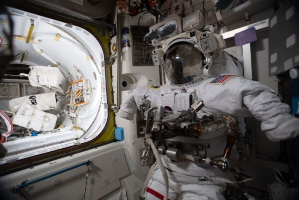 ASTRONAUTS COMPLETE SPACEWALK OUTSIDE SPACE STATION