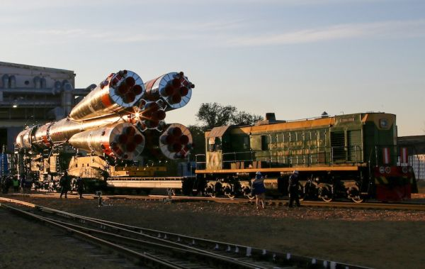 RUSSIAN ROCKET FOR NEXT SPACE STATION CREW TRANSFERRED TO LAUNCH PAD