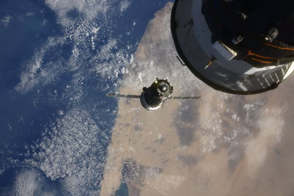 SOYUZ CREW DOCKS WITH INTERNATIONAL SPACE STATION