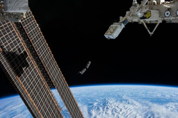 ASTRONAUTS SET TO LAUNCH SECURITY SATELLITE FROM SPACE STATION