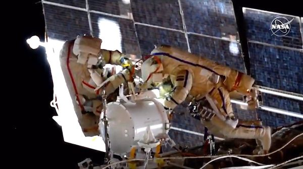 SPACEWALKERS PREP FOR ARRIVAL OF NEW RUSSIAN MODULE