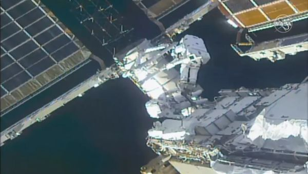 SPACEWALKING ASTRONAUTS PREPARE INTERNATIONAL SPACE STATION FOR NEW SOLAR ARRAYS