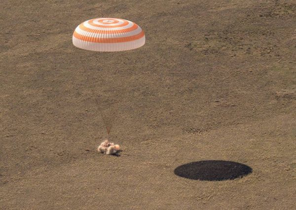 RUSSIAN CAPSULE BRINGS HOME THREE SPACE FLIERS